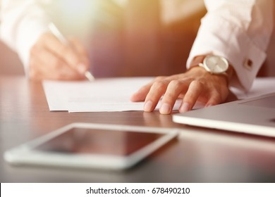 Man signing documents at table. Consulting service concept