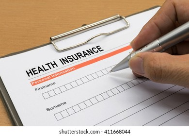 man signing a health insurance policy