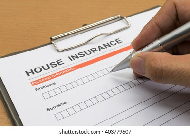 man signing a house insurance policy