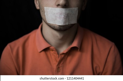 Man is silenced with adhesive tape on his mouth.