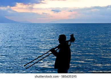 man silhouette near the sea
