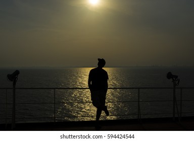A man silhouette on sunset background