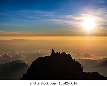 A Man Silhouette sitting on top of the mountain, Mount Rinjani, Lombok island in Indonesia.