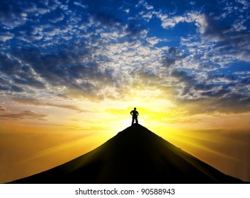 man silhouette stay on a mountain top