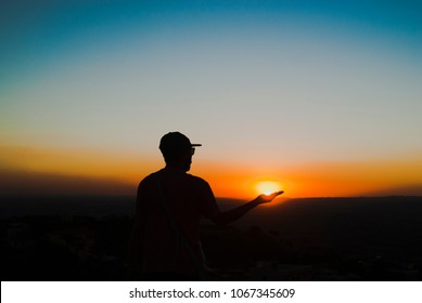 Man silhouette at sunset in Brazil