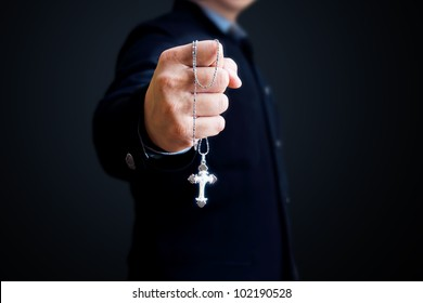 A man with the silver cross in his hand