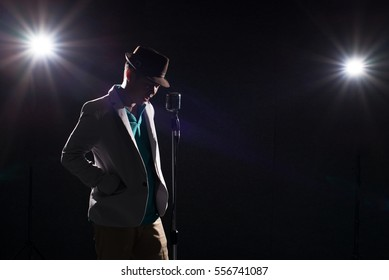 man singer in dark with lens flare effect