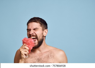 man sings with a washcloth on a blue background, beauty, shower