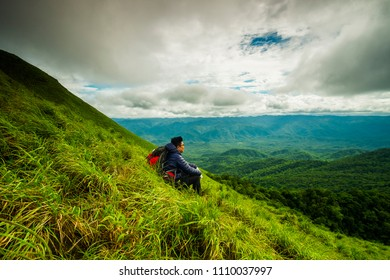a man  sit on the ground after sumit at Doi Lung Tak, 1175 msl, Tak province Thailand