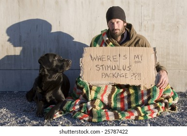 A man sits with a cardboard sign asking where his share of the stimulus package is.