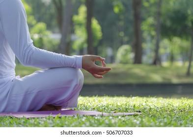 Man sits in Park for meditation.