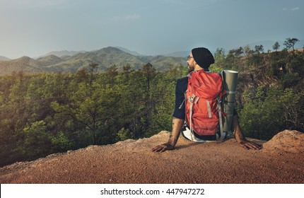Man Sitting Alone Cliff Backpacker Concept