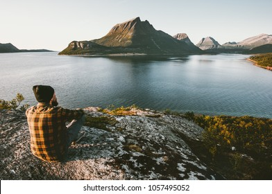 Man sitting alone enjoying sea and mountains view Travel lifestyle adventure outdoor summer vacations wild nature