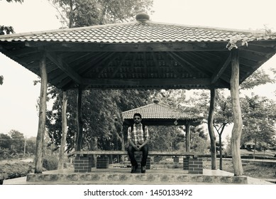 Man sitting around a place in a recreational park area