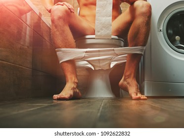 Man sitting bath. Funny photo. People in love. Positions kamasutra. Erotic moments. Concept photo. Secret. Fashion. Hot babe. Party. Night background. Sensual. Sex. Sensual. Funny. Strong male. Guy.