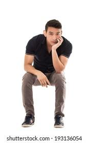 man sitting bored waiting on white background
