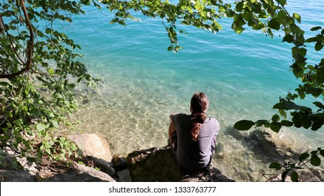 A man sitting by the lake. Location: Europe, Austria, Attersee