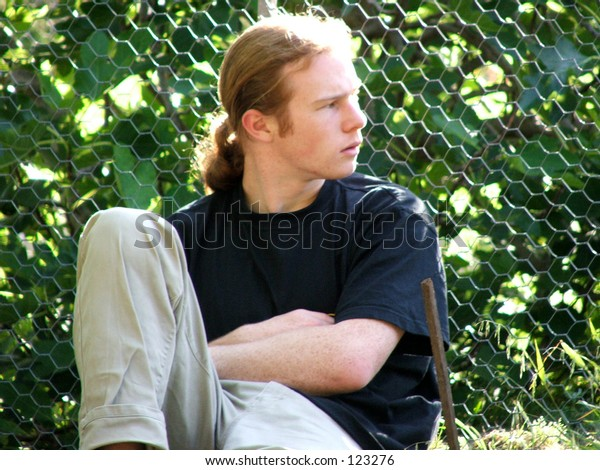 Man sitting casually on lawn