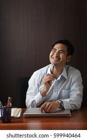 Man sitting at desk smiling