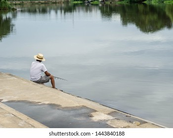Man sitting fishing In the river