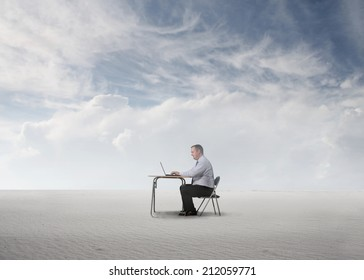 man sitting at his desk isolated in an empty space