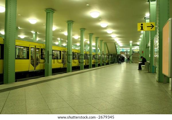 man sitting at lonely underground station