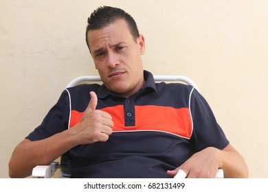 man sitting and looking at the camera
