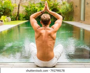 Man sitting in lotus yoga position