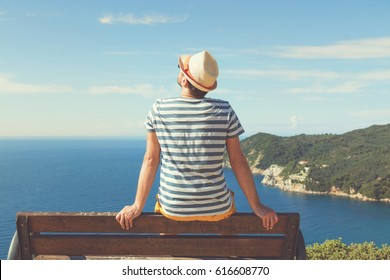 Man sitting on the bench and enjoying the view. Summer concept.