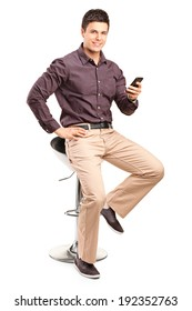 Man sitting on chair and holding cell phone isolated on white background