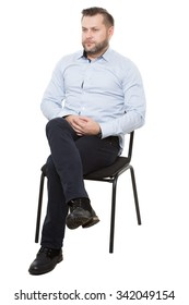man sitting on chair. Isolated white background, arms crossed, mistrust