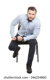 man sitting on chair. Isolated white background. Body language. gesture of readiness for action. starting position