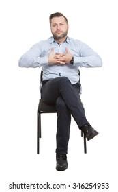 man sitting on chair. Isolated white background. Body language. linked fingers
