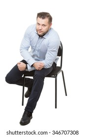 man sitting on chair. Isolated white background. Body language. gesture of readiness for action. starting position. Training managers. sales agents