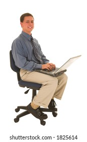 Man sitting on a chair working on laptop.