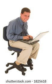 Man sitting on chair working on a laptop.