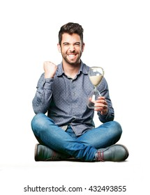 man sitting on the floor holding a sand timer