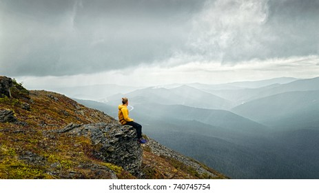 Man sitting on a mountain and thinks