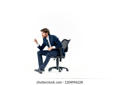 man sitting on an office chair side view
