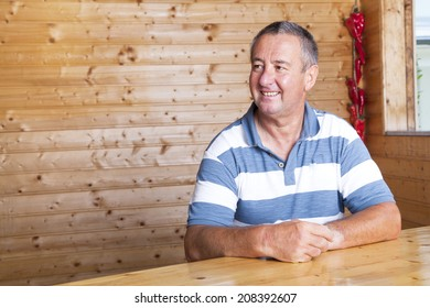 Man sitting on rustic table