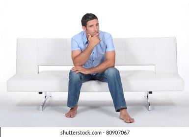 Man sitting on a sofa