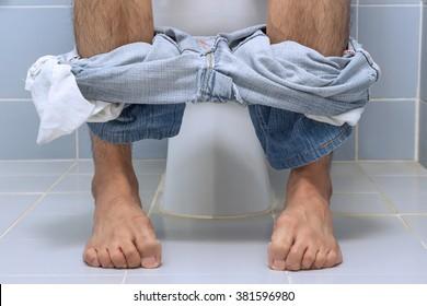 Man sitting on toilet, diarrhea