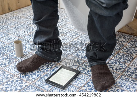 Man Sitting On Toilet Reading Ebook Stock Photo (Edit Now) 454219882