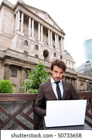 Man sitting outside the Bank of England building