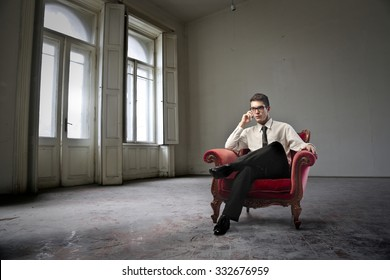 Man sitting in a red armchair