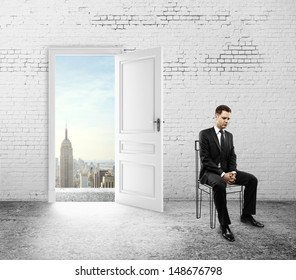 man sitting in room with open doors