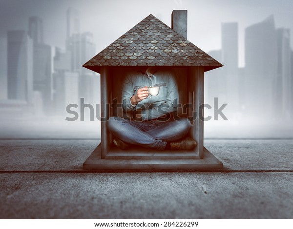 Man sitting in a tiny house