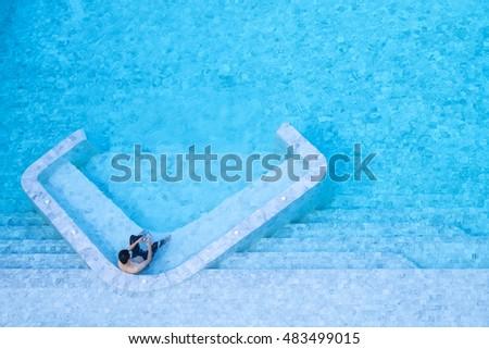 Man Sitting Water Bar Inside Pool Stock Photo Edit Now 483499015