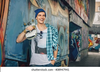 Man Skateboarder Lifestyle Relax. Listen music. Hipster Concept