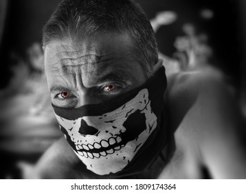 man with skeleton mask and fire red eyes